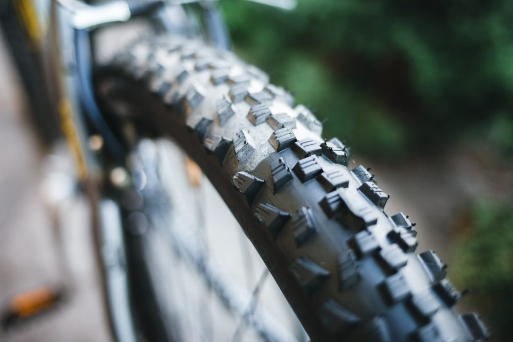 Bicycle rubber before and after cleaning. Tire care concept