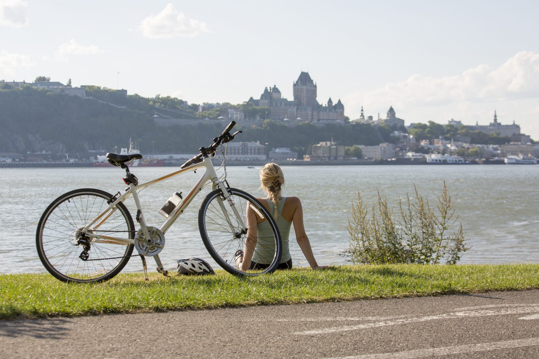 Young Woman with Bike outside with quebec view
